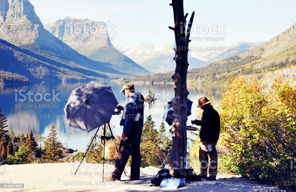 Artists at work in Glacier National Park, Montana,USA stock photo