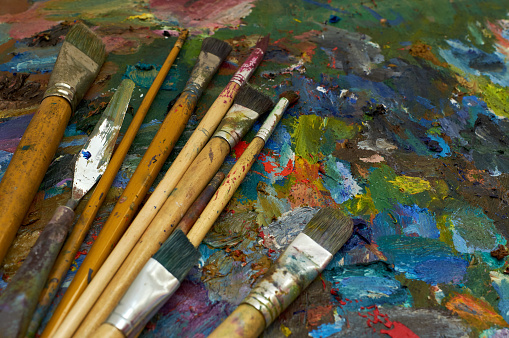 577949148 istock photo artists brushes and oil paints on palette 1178960126