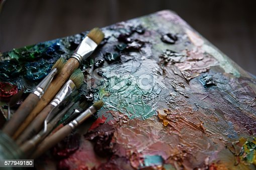 istock artists brushes and oil paints on wooden palette 577949180