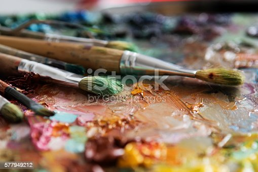 istock artists brushes and oil paints on wooden palette 577949212
