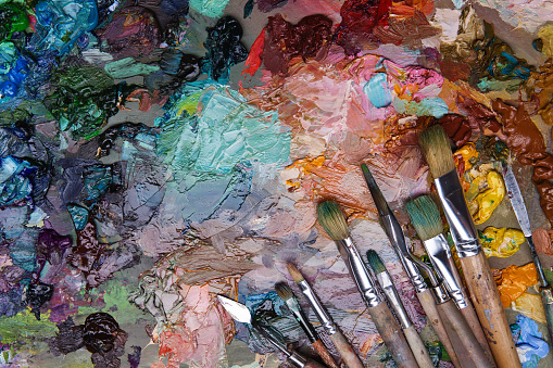 577949148 istock photo artists brushes and oil paints on wooden palette 577949914