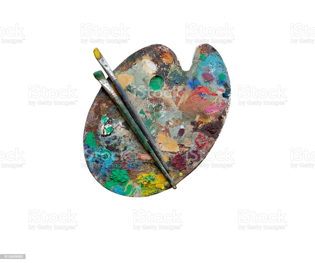 Artists brushes and oil paints on wooden palette stock photo
