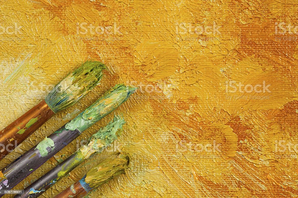 Artists brushes on artistic background stock photo