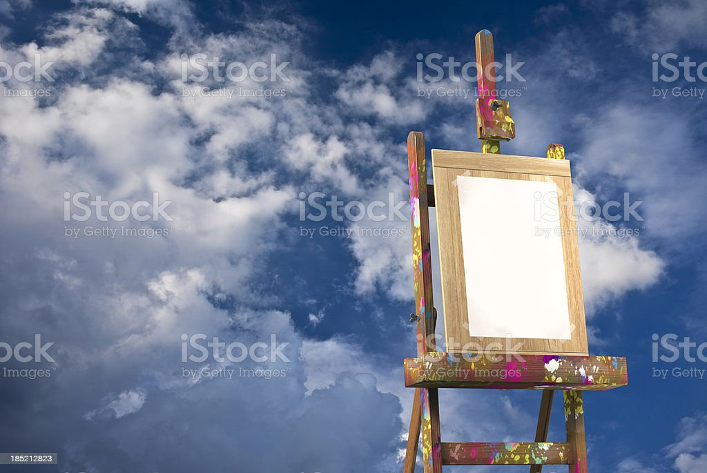 Artist's canvas and fluffy summer clouds stock photo