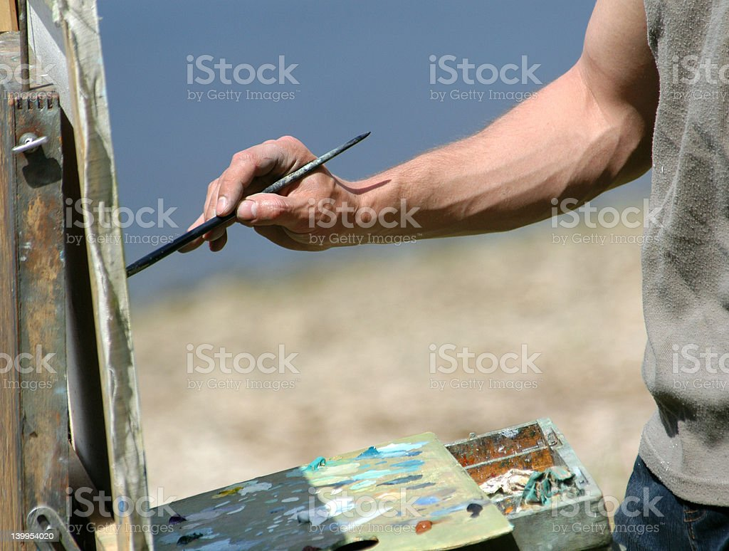 Artist's Hand with a Brush royalty-free stock photo