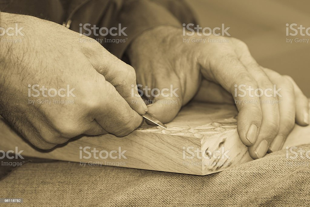 Artist's Hands Carving Closeup, Sepia Toned royalty-free stock photo