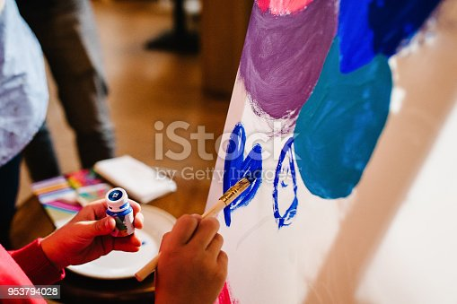 istock Artists hands with brush and paint, paints on easel, painting at studio. Color drawing, picture. Ð¡lose up art, creativity, people concept. 953794028