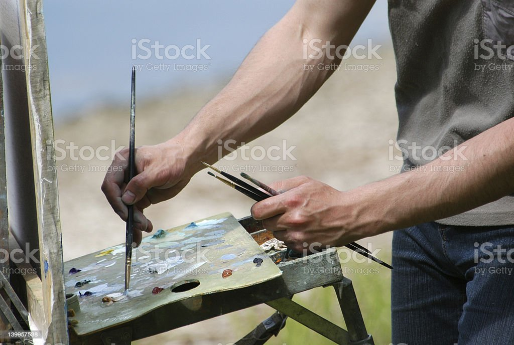 Artist's Hands with Brushes royalty-free stock photo