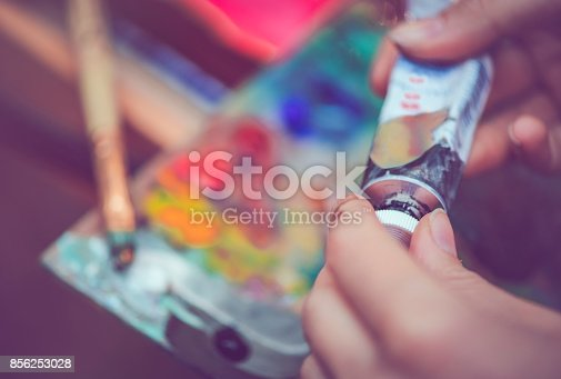 istock Artist's hands with paint tube 856253028