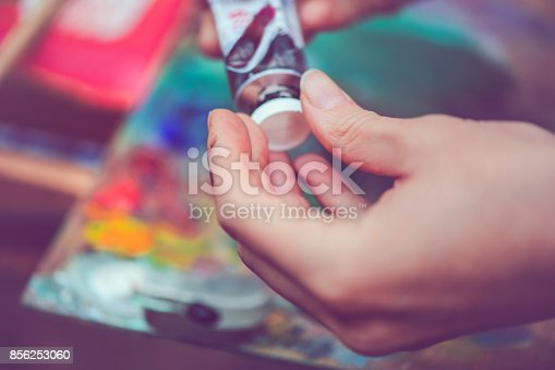 istock Artist's hands with paint tube 856253060