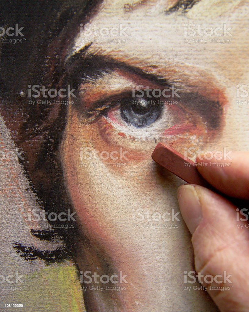 Artist's Hand's Working on Pastel Portrait of Man's Face stock photo
