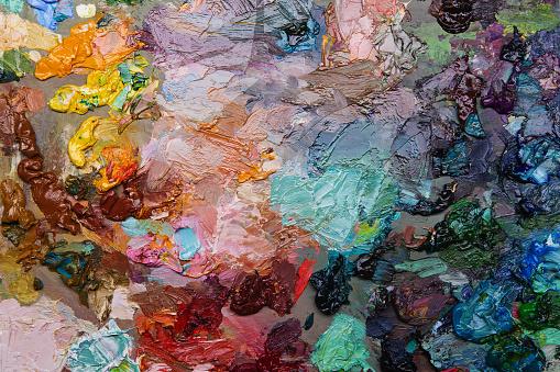 577949148 istock photo artists oil paints on wooden palette. 577949742