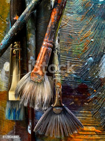 186199100istockphoto Artists Paint Palette and Brushes 512804842