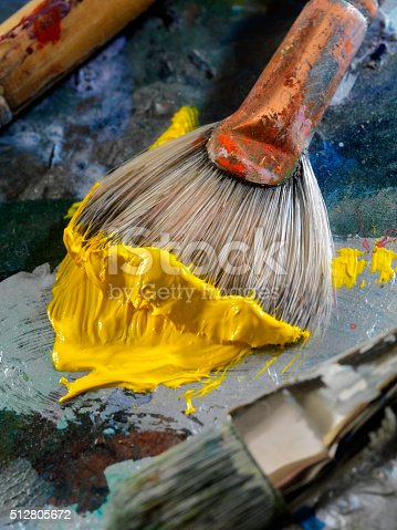 186199100istockphoto Artists Paint Palette and Brushes 512805672