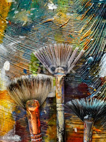 186199100istockphoto Artists Paint Palette and Brushes 512816578
