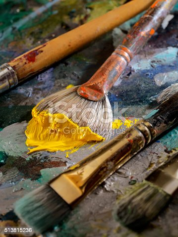 186199100istockphoto Artists Paint Palette and Brushes 513815236