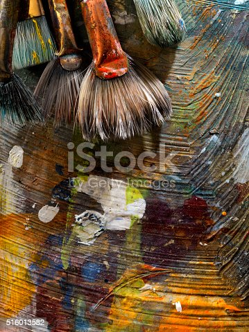 186199100istockphoto Artists Paint Palette and Brushes 516013582