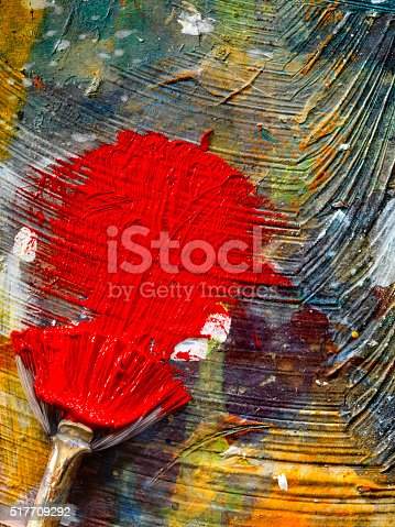 186199100istockphoto Artists Paint Palette and Brushes 517709292