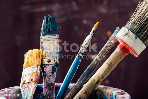 Artist's paintbrushes with equipments.