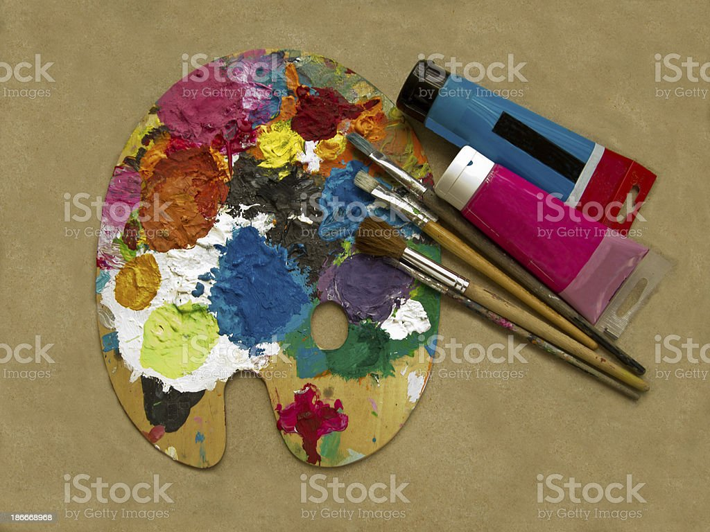 Artist's palette, brushes on  beige background stock photo
