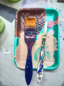 Artists paint palette close-up at studio