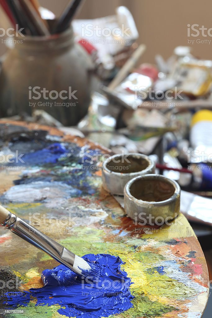 Artist's Studio with paintbrush on a classical palette royalty-free stock photo