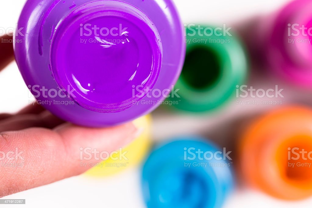 Arts and Crafts: Artist holds jar of purple paint. royalty-free stock photo