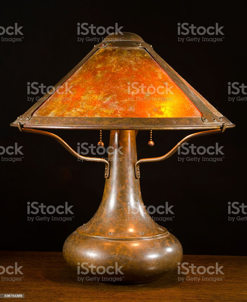 Arts and Crafts Copper Table Lamp with Mica Shade stock photo