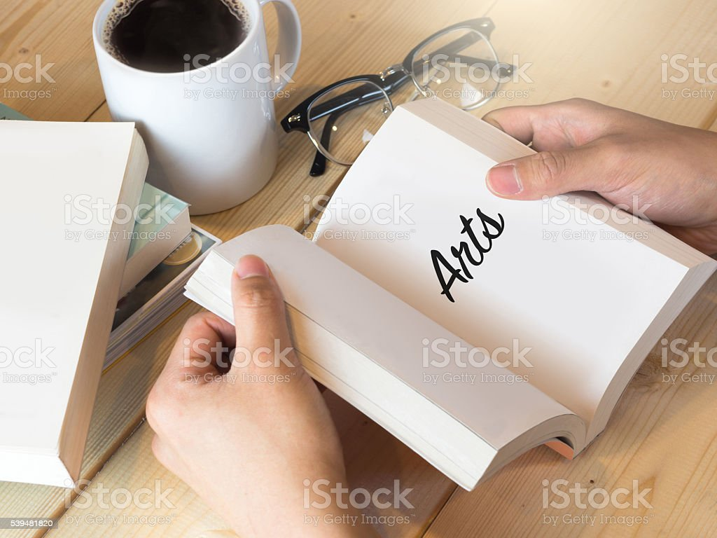 Arts on opened book on study table stock photo