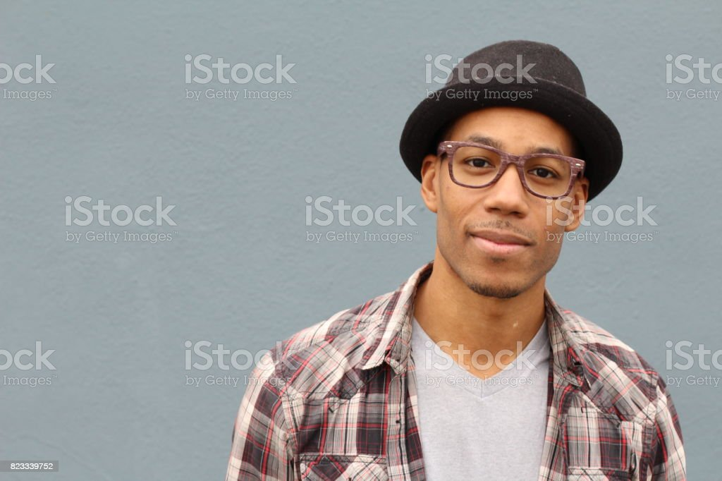 Artsy looking student smiling on campus stock photo