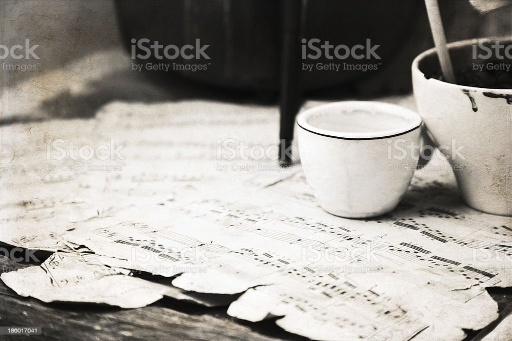 artwork  in retro style, cup of coffee and music-paper royalty-free stock photo