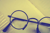 istock Artwork in retro style, Spectacles and book , vintage styled 611636596