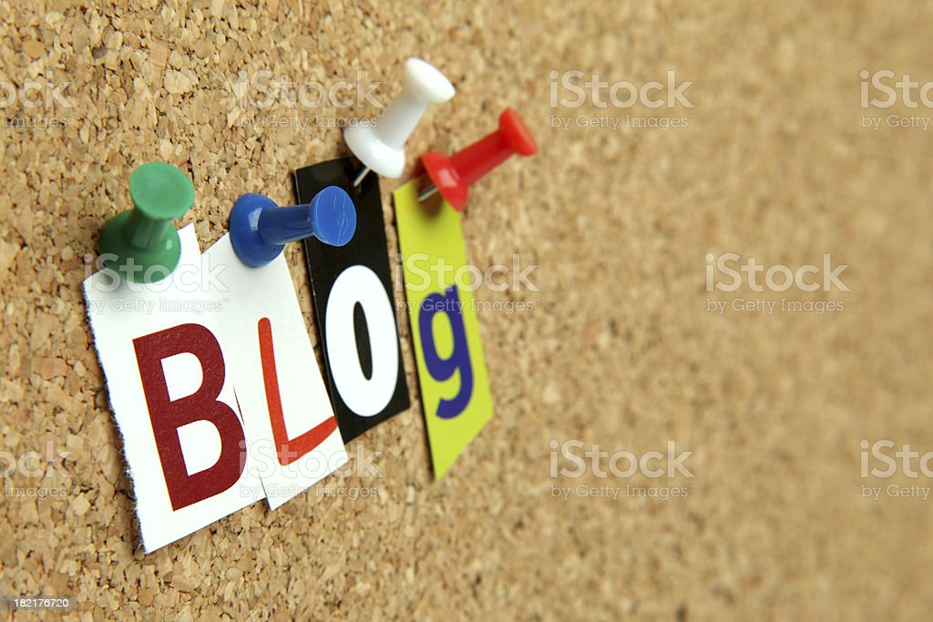 Arty photo of the letter 'Blog' pinned on a cork-board royalty-free stock photo