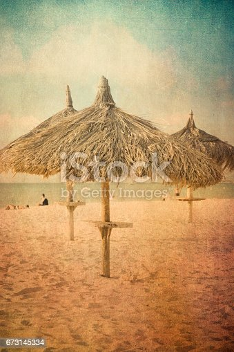 Vintage texture style view of tropical beach with grass hut palapas