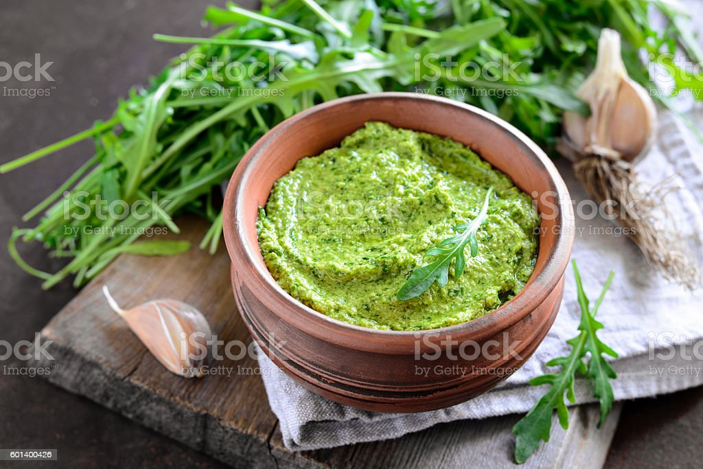 Arugila pesto in a rustc bowl stock photo