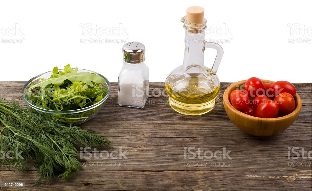 Arugula, greens, tomatoes and spices stock photo