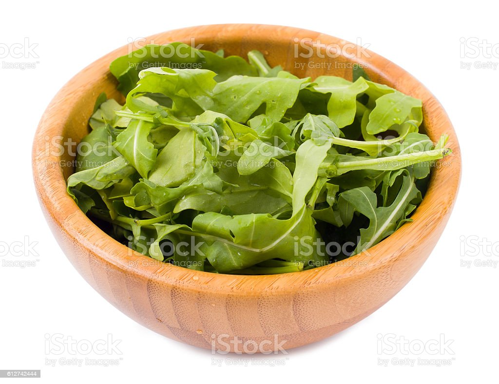 Arugula in a bamboo bowl stock photo