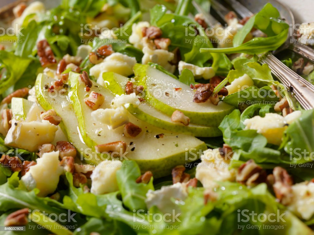 Arugula, Pear and Brie Salad with Walnuts stock photo