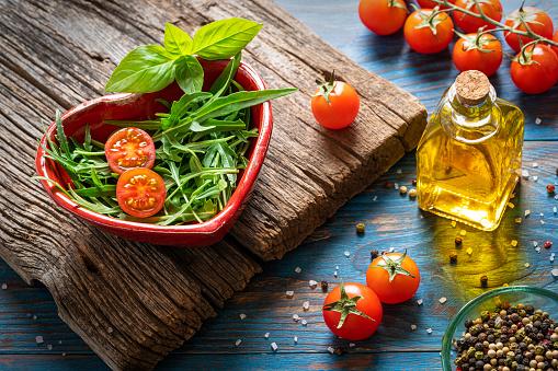 Arugula salad heart shape cherry tomato