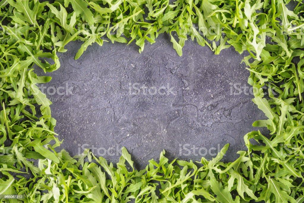 Arugula salad rucola leaves frame food background zbiór zdjęć royalty-free