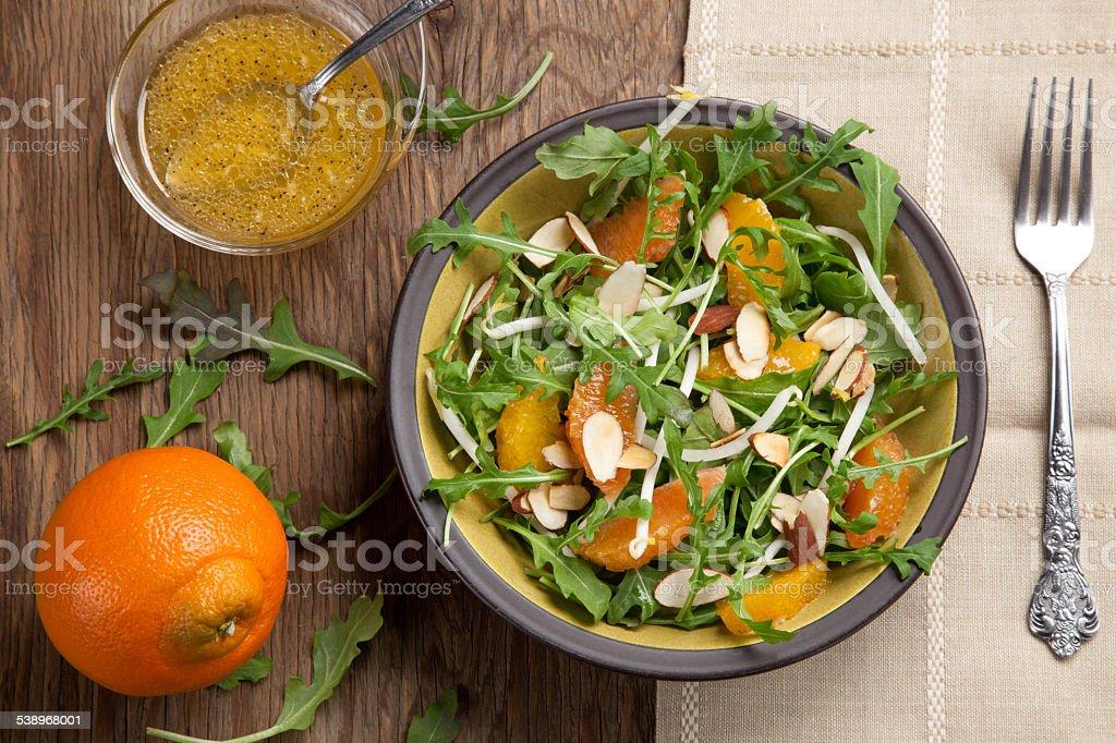 Arugula Salad with Mandarin Vinaigrette stock photo