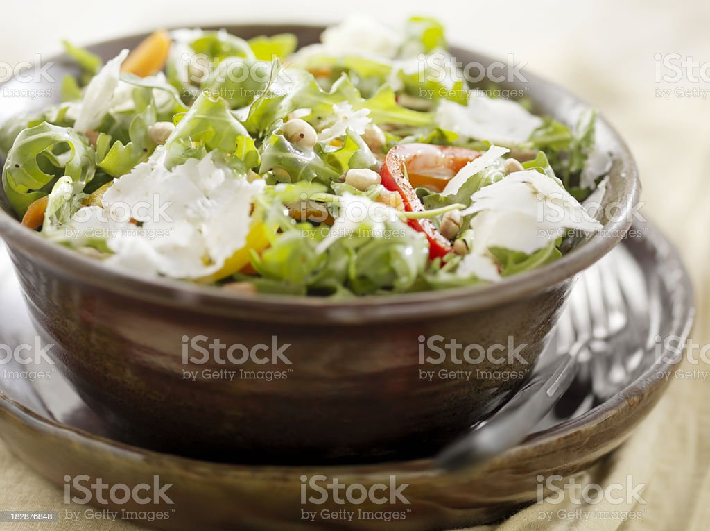 Arugula Salad with Peppers, Pine Nuts and Grated Cheese royalty-free stock photo