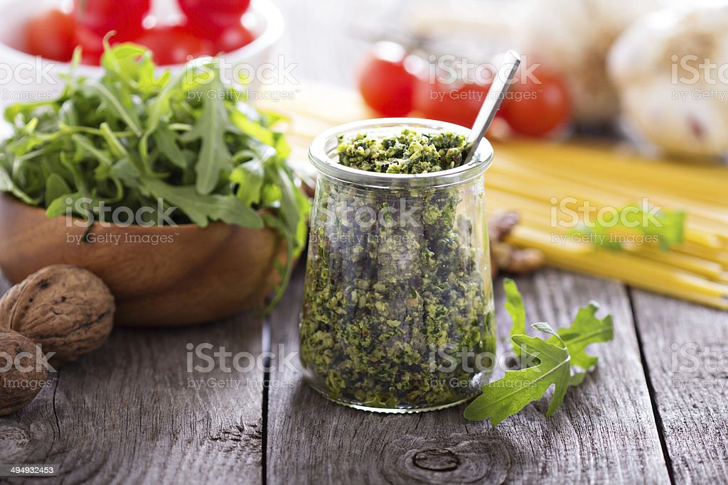 Arugula walnut pesto stock photo