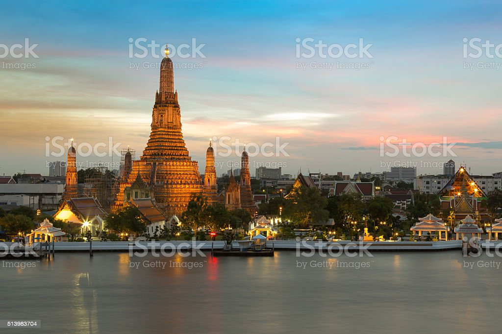 Arun pagoda temple waterfront after sunset stock photo