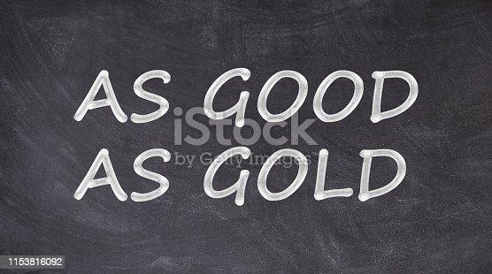 istock As good as gold written on blackboard 1153816092