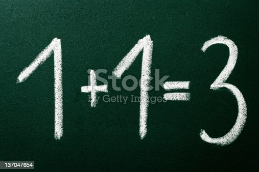 istock 1+1=3 as mathematical calculations on green blackboard 137047654