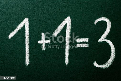 532357605istockphoto 1+1=3 as mathematical calculations on green blackboard 137047654