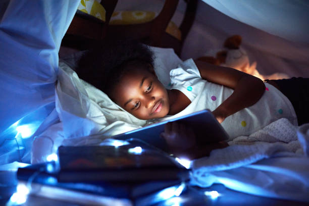 as you grow up, teddies are replaced with tablets - natural phenomenon stock photos and pictures