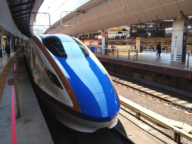 Asama, a Japan Railways Shinkansen high speed bullet train waits to depart from Tokyo station The Asama is a high-speed Shinkansen train service operated by East Japan Railway Company (JR East) on the Hokuriku Shinkansen in Japan. depart stock pictures, royalty-free photos & images