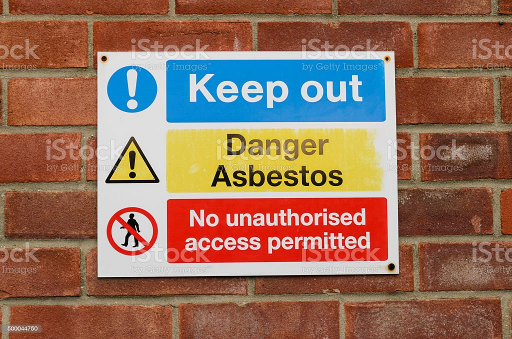 asbestos danger sign stock photo